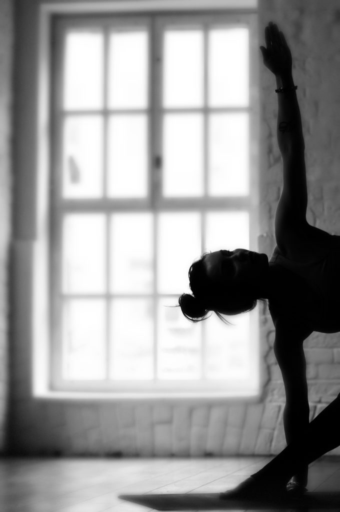 dragonfly yoga teacher training website 2018 triangle pose black and white (1)